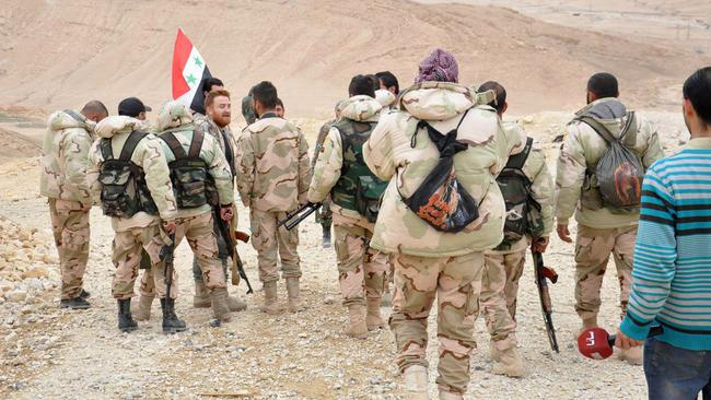 Major win ... Syrian soldiers take up positions in the battle to recapture Palmyra. Picture: SANA via AP