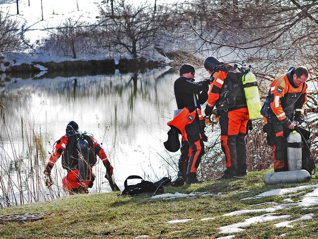 Police search a duck pond near where Nicole's body was found.