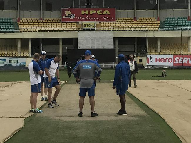 Australian coach Darren Lehmann (centre) inspects the pitch at Dharamsala.