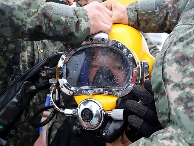 Recovery operation ... a diver wears a helmet to look for people still missing from the sunken ferry in the water off South Korea's southern coast, near Jindo.