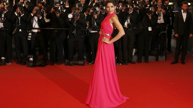 """Indian actress Freida Pinto poses on May 15, 2013 as she arrives for the screening of the film """"The Great Gatsby"""" ahead of the opening of the 66th edition of the Cannes Film Festival in Cannes. Cannes, one of the world's top film festivals, opens on May 15 and will climax on May 26 with awards selected by a jury headed this year by Hollywood legend Steven Spielberg. AFP PHOTO / VALERY HACHE"""