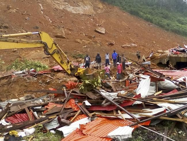 People survey the damage after mudslides in Regent, east of Freetown, Sierra Leone. Picture: AP