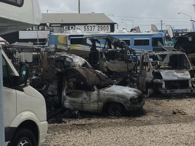 Motorhomes have been destroyed at an Arundel car yard after fire guttered them. Photo: Nicholas McElroy