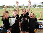Aldinga Sharks under 10s LIam Phillips, Sean Finlay, Jess Harris and Jaxon Phillips cheer their team. Picture: Mark Brake
