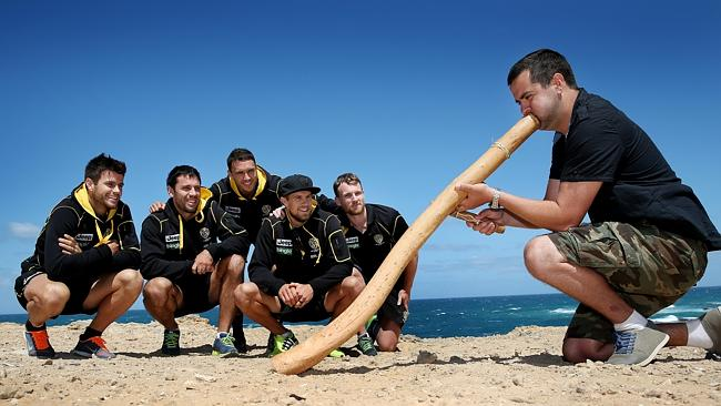 Trent Cotchin,Troy Chaplin, Shane Edwards, Brett Delidio and Nathan Foley watch on as Didgeridoo player and local Paul Kelly welcomes them during a welcoming ceremony at Thunderpoint.