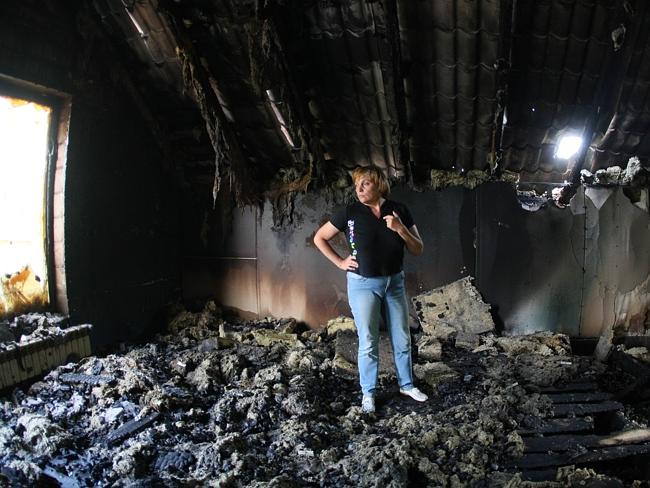 Aftermath ... a woman inspects her building destroyed as a result of combat between Ukrainian troops and pro-Russia separatists near the airport in Donetsk. Picture: Alexander Khudoteply