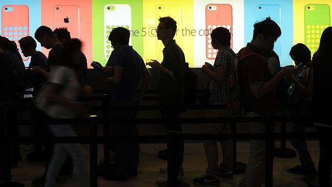 It's clear people love Apple. But it shouldn't be so hard for people to learn how to get the most out of their devices. Picture: AFP