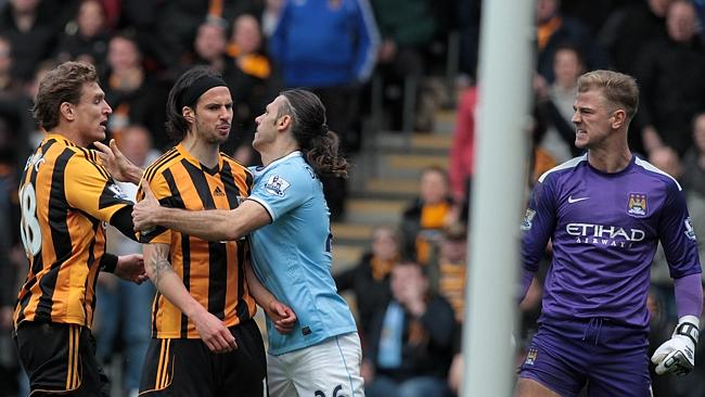 George Boyd (2nd L) is held by Manchester City's Argentinian defender Martin Demichelis.