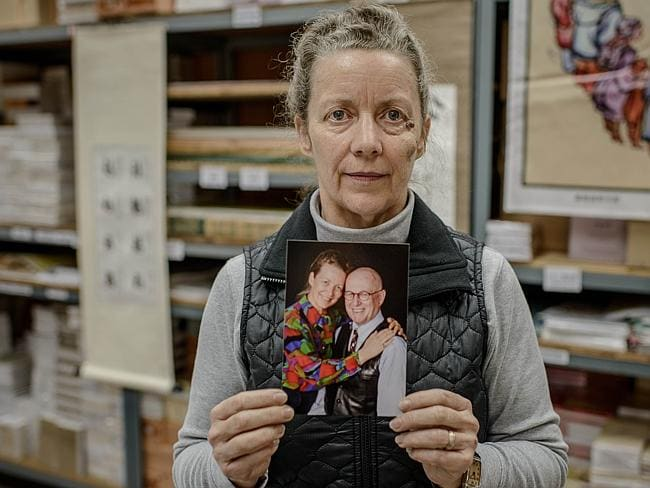 Karen Short holds a picture of herself and her husband John.