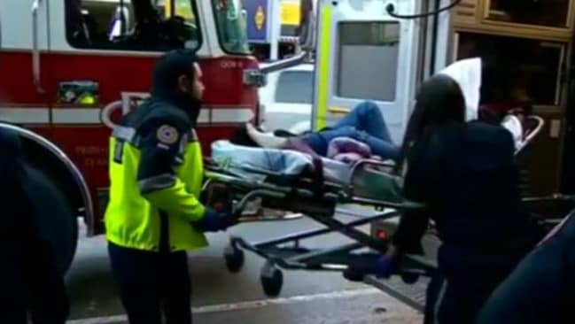 Injured ... A passenger is loaded into an ambulance after being hurt on Air Canada flight AC088
