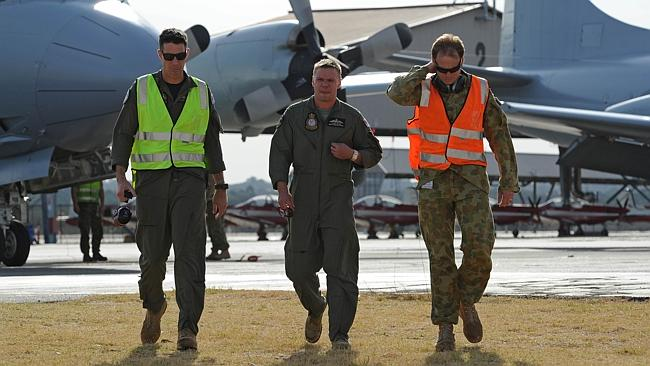 Determined to find the object ... Royal Australian Airforce Flying Officer Peter Moore (centre) after returning his RAAF Orion plane to Pearce Air Force base in Bullsbrook, 35 kms north of Perth.