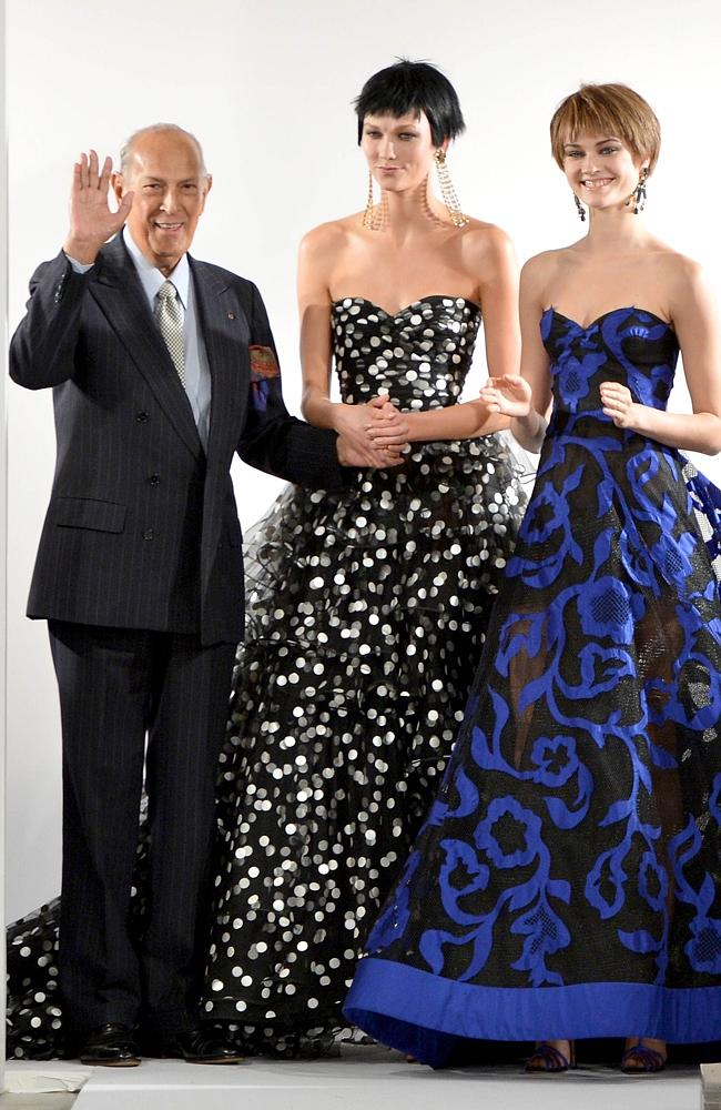 Designer Oscar De La Renta poses on the runway at the Oscar De La Renta fashion show duri