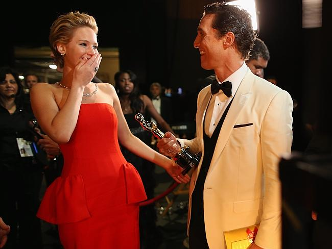 Jennifer Lawrence and Best Actor Award winner Matthew McConaughey backstage during the Oscars.