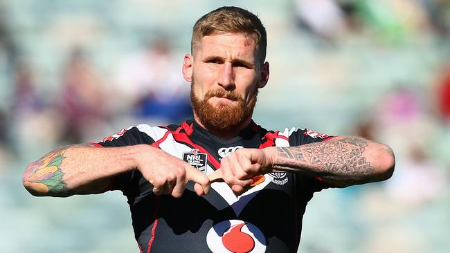Sam Tomkins celebrates after scoring a try.