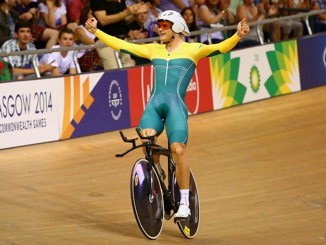 Scott Sunderland celebrates winning gold in the 1000m time trial in Games record time.