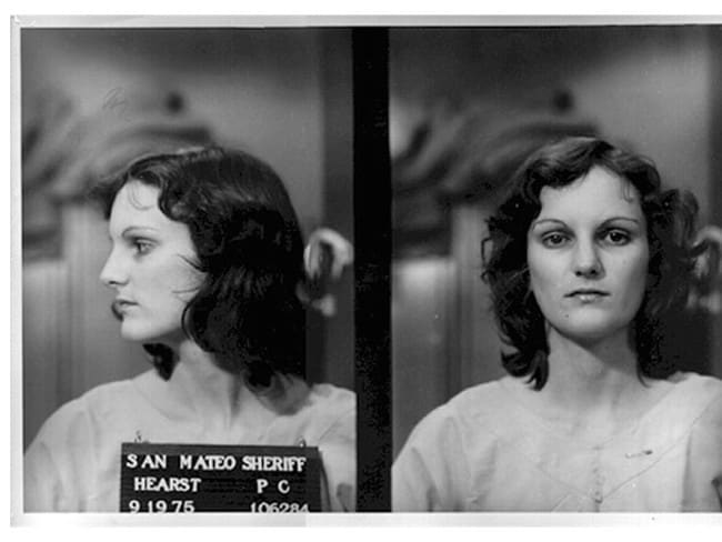 William Randolph Heart's granddaughter Patty Hearst after her arrest on bank robbery and gun charges. Hearst was kidnapped by the Symbionese Liberation Army in February 1974.