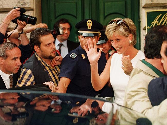 A famous photo taken by Arthur Edwards ... of Diana, the late Princess of Wales, being mobbed by a crowd while leaving a cafe in 1996 in Italy. Picture: London Sun / Arthur Edwards.