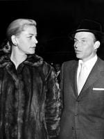 "Frank Sinatra, right, and Lauren Bacall arrive at a film preview of ""Pal Joey"" in Hollywood. Picture: AP"