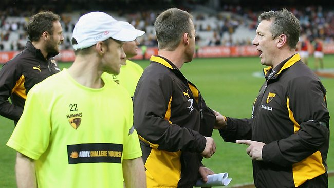 Hawthorn coach Alastair Clarkson is held back by Mark Evans after the match between Hawthorn and Essendon at the MCG.