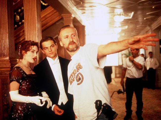 Director James Cameron (right) with actors Kate Winslet and Leonardo DiCaprio on set in the Titanic in 1997.