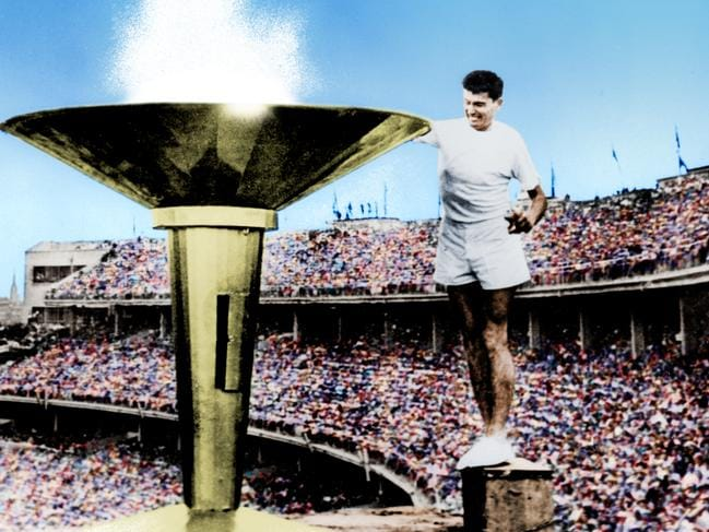 flame lighting olympics. colorized version of ron clarke lighting the olympic flame in 1956 melbourne olympics