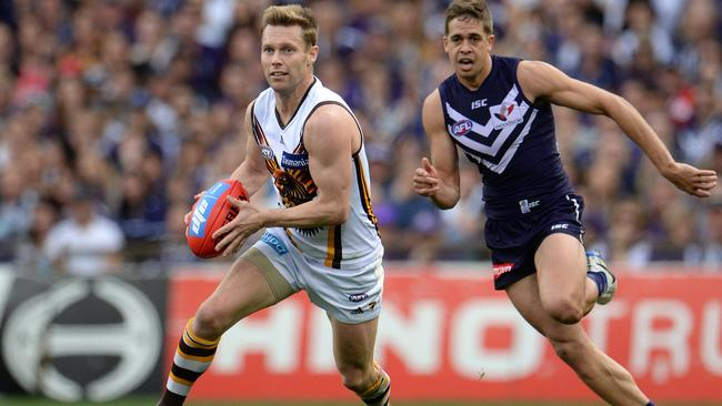 Hawk Sam Mitchell runs away from Stephen Hill. Picture: Daniel Wilkins
