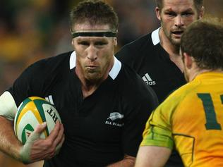 BRISBANE, AUSTRALIA - AUGUST 27: Brad Thorn of the All Blacks is tackeld by Pat McCabe of the Wallabies during the Tri-Nations Bledisloe Cup match between the Australian Wallabies and the New Zealand All Blacks at Suncorp Stadium on August 27, 2011 in Brisbane, Australia. (Photo by Phil Walter/Getty Images)
