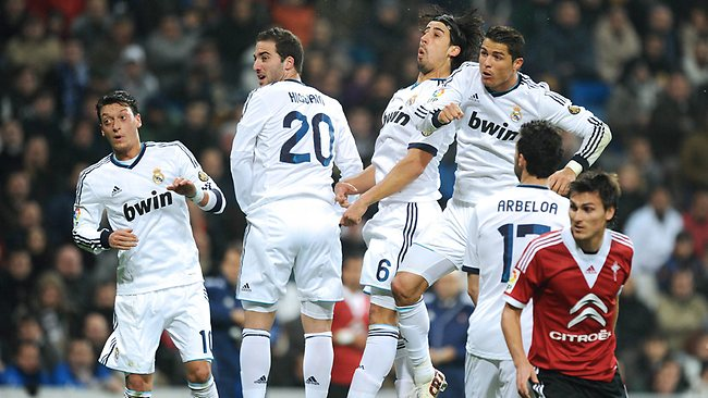 From left, Real Madrid's German midfielder Mesut Ozil, Argentinian forward Gonzalo Higuain, German midfielder Sami Khedira and forward Cristiano Ronaldo jump in a bid to head the ball in their side's 4-0 win over RC Celta de Vigo at the Santiago Bernabeu stadium in Madrid. Picture: AFP