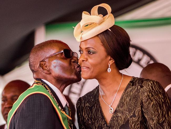 Robert Mugabe kisses his wife and first lady Grace during the country's 37th Independence Day celebrations in April. Picture: Jekesai Njikizana/AFP