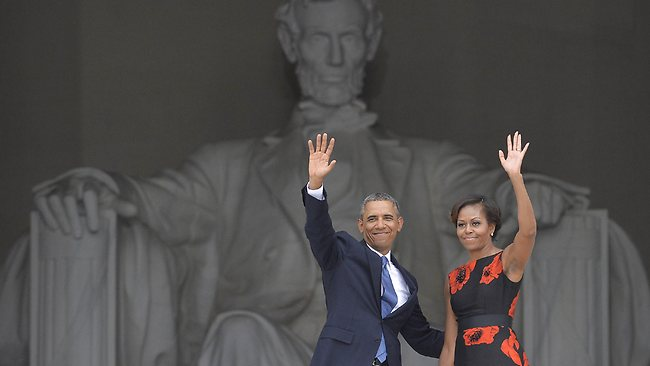 US President Barack Obama and First Lady Michelle Obama wave during the Let Freedom Ring Commemoration and Call to Action to commemorate the 50th anniversary of the March on Washington for Jobs and Freedom at the Lincoln Memorial in Washington, DC on August 28, 2013. The March on Washington is best remembered for King's stirring vision of a United States free of inequality and prejudice, telecast live to a nation undergoing a phenomenal decade of soul-searching, crisis and change. AFP Photo/Jewel Samad