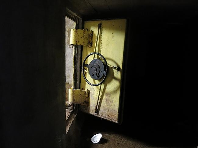 Escape hatch ... a steel reinforced door leads to a series of interconnected tunnels in the city's drainage system in the city of Culiacan, Mexico was used by Guzman to move around undetected. Picture: Adriana Gomez