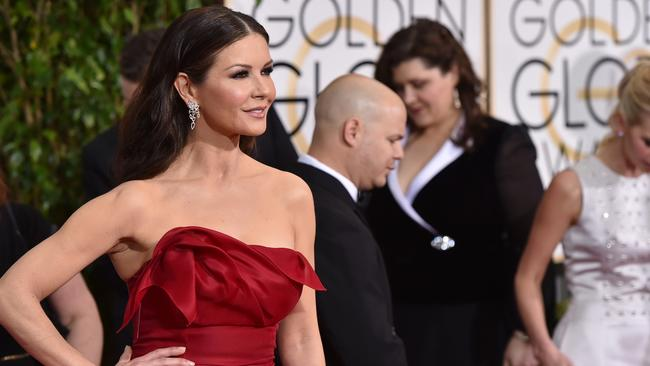 Bold red ... Catherine Zeta-Jones arrives. Picture: AP