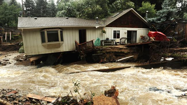 What looks like a river in fact used to be the front and back yards of the residents of these homes in Jamestown, Colorado. Photo: AP/The Denver Post