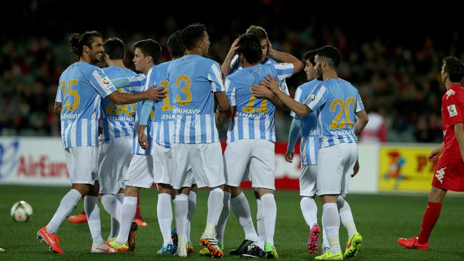 Malaga players celebrate a goal at Adelaide Oval. Picture: Simon Cross.