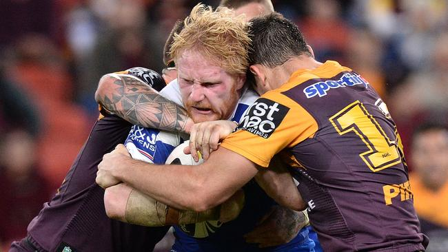 James Graham of the Bulldogs attempts to push through the Broncos defence in round 22.