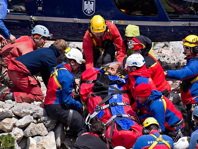 Freeded ... mountain rescuers carry cave researcher Johann Westhauser to a helicopter after he was injured and spent almost two weeks trapped in the underground caves 1000 metres deep. Picture: AP