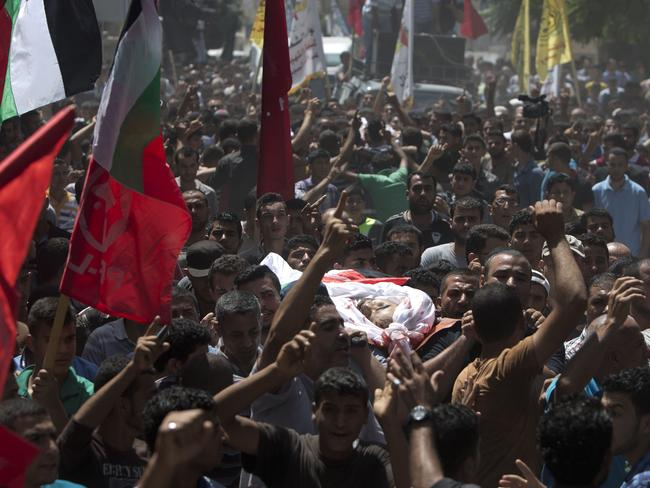 Struck down ... mourners at the funeral of Islamic Jihad commander Hafez Hammad in Beit Hanun. Picture: Mahmud Hams