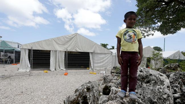 A young boy poses for the camera at the asylum seeker and refugee processing camp on Nauru. Picture: Kelly Barnes