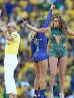 (L - R) Singers Pitbull, Claudia Leitte and Jennifer Lopez perform during the Opening Ceremony of the 2014 FIFA World Cup Brazil prior to the Group A match between Brazil and Croatia at Arena de Sao Paulo on June 12, 2014 in Sao Paulo, Brazil. (Photo by Adam Pretty/Getty Images)