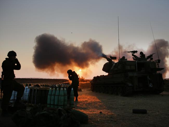 Israeli soldiers fire towards the Gaza Strip on July 21. AFP PHOTO/MENAHEM KAHANA