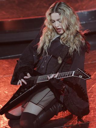 Madonna plays Burning Up in China. Picture: AP Photo/Kin Cheung.