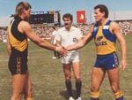 Ross Glendinning shakes hands with Richmond captain Mark Lee before West Coast's first game in 1987.