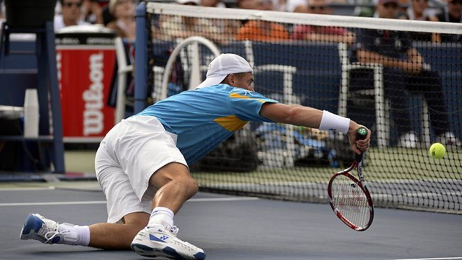 Lleyton Hewitt of Australia dives for a return against Mikhail Youzhny of Russia - and the shot went in.