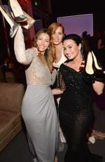 Kicking off their heels at the Vanity Fair party... Jessica Biel, Amy Adams and Demi Lovato. Picture: Kevin Mazur/VF16/WireImage
