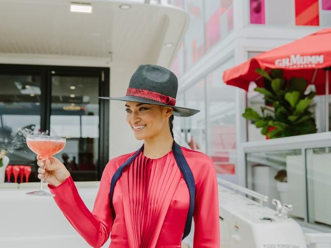 Shanina Shaik with a 'yacht-tail' in the GH Mumm marquee during yesterday's Birdcage preview at Flemington. Picture: Supplied
