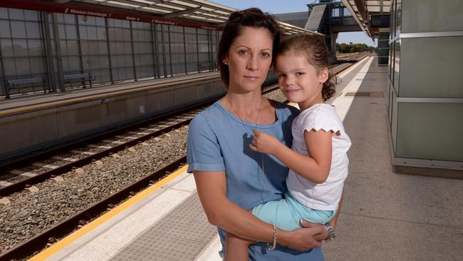 Gulfview Heights Mum Heather Krombholz, 40, and daughter Kahlee, 4 at Mawson Lakes railway station where the report says electrification is urgently needed to replace old diesel trains. Pic: Keryn Stevens