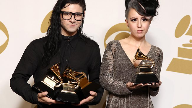 "Skrillex, left, winner of the awards for best dance/electronica album ""Bangarang,"" best remixed recording non-classical song for ""Promises"" and best dance recording ""Bangarang,"" and Sirah pose backstage with the award for best dance recording ""Bangarang''."