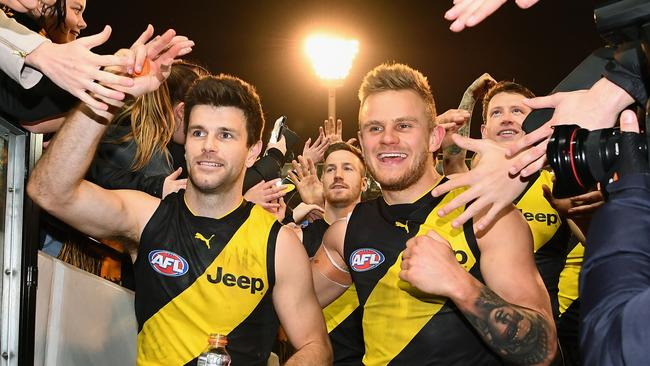 Trent Cotchin and Brandon Ellis after Richmond's qualifying final win.