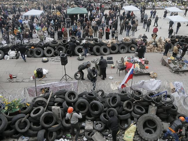 Barricade ... pro-Russia activists are demanding a referendum on joining their eastern neighbour.