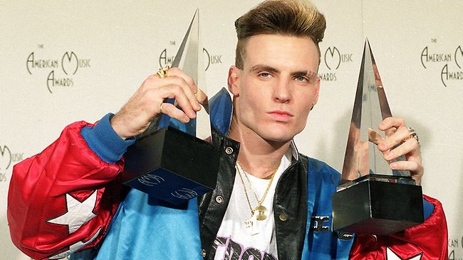 """Vanilla Ice displays his awards he won in the rock and rap catagories at the American Music Awards in this Jan. 28, 1991 file photo. The 36-year-old rap performer, who had a '90s hit with """"Ice Ice Baby,"""" called animal control officials Wednesday to report that a wallaroo and a goat found wandering around Port St. Luciem Florida belong to him. (AP Photo/Reed Saxon)"""